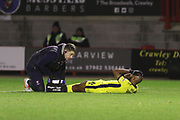 Nigel Atangana goes down injured during the EFL Sky Bet League 2 match between Crawley Town and Cheltenham Town at the Broadfield Stadium, Crawley, England on 5 January 2019.