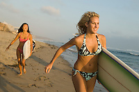 Blond Surfer in Bikini Running Towards Water