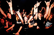 "Nu Metal ""Cradle Of Filth"" fans do the devil horn hand signal, UK 2000s."