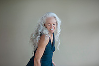 mature woman feeling good in her movement practice.