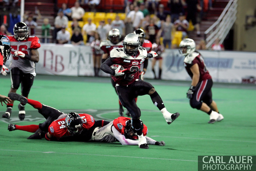 6-28-2007: Anchorage, AK - Alaska's Demarcus Morris (3) leaps over the defense in the Alaska Wild 47 to 53 loss to the CenTex Barracudas at the Sullivan Arena...