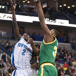 Feb 17, 2010; New Orleans, LA, USA; New Orleans Hornets guard Darren Collison (2) shoots over Utah Jazz forward C.J. Miles (34) during the second quarter at the New Orleans Arena. Mandatory Credit: Derick E. Hingle-US PRESSWIRE