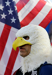 A soccer fan, wearing an eagle mask, looks on to the field before a men's international friendly soccer match between The United States and Bolivia, Saturday, May. 28, 2016, in Kansas City, Kan.  (AP Photo/Colin E. Braley)