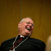 Archbishop Timothy Dolan at a press conference