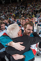 KELOWNA, CANADA - MAY 13: Colten Martin #8 of Kelowna Rockets hugs GM Bruce Hamilton during WHL championship celebrations on May 13, 2015 during game 4 of the WHL final series at Prospera Place in Kelowna, British Columbia, Canada.  (Photo by Marissa Baecker/Shoot the Breeze)  *** Local Caption *** Colten Martin; Bruce Hamilton;