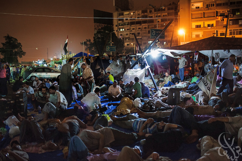 Egyptian supporters of deposed President Mohamed Mosi rest in tents and on the ground after a long day of marches Friday July 19, 2013 at the Rabaa al-Adawiya mosque/square in Nasr City. For 3 weeks, protesters angry with the decision of the military to remove Morsi from power have been camped out at the mosque by the thousands, and have vowed to remain until Morsi is returned to power.