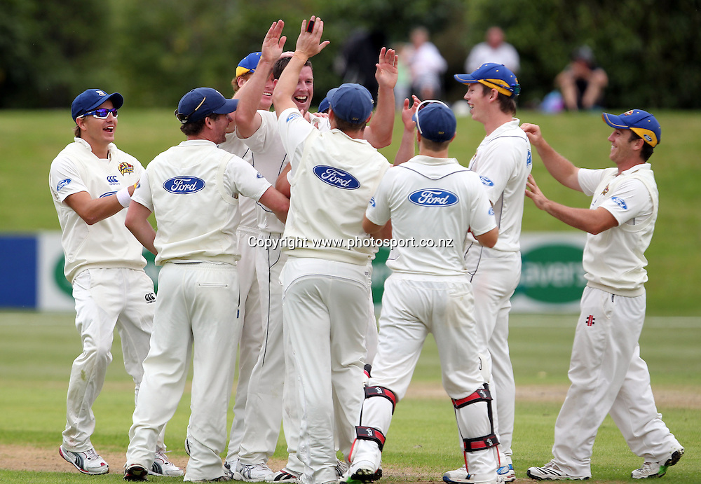 The Otago Volts celebrate another wicket for Ian Butler.<br /> Cricket - Otago Volts v Central Stags. Plunket Shield Cricket Match. University Oval, Dunedin. Monday 14 March 2011.<br /> Photo: Rob Jefferies/PHOTOSPORT
