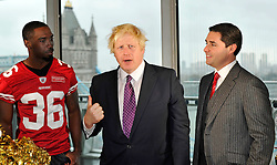 26.10.2010, City Hall, London, ENG, NFL, Photocall San Francisco 49ers and 49ers Goldrush Cheerleader, to Promote the NFL Game between Denver Broncos and the San Francisco 49ers to be played at Wembley Stadium, im Bild Boris Johnson(C) Mayor of London is talks to 49ers player Shawntee Spencer (L) and Jed York (R)owner of the 49ers  with Tower Bridge in the background. EXPA Pictures © 2010, PhotoCredit: EXPA/ IPS/ Sean Ryan +++++ ATTENTION - OUT OF ENGLAND/UK +++++