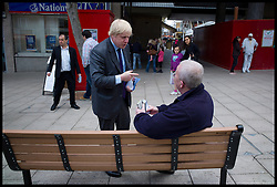 London Mayor Boris Johnson campaigning in Wallington high street, during his Mayoral campaign, London, April 5, 2012. Photo By Andrew Parsons/i-Images.
