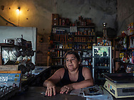 Argentina, 57 - Portrait - She's working in a Kiosko/bus stop, her husband is a horse trainer, her daughter (15) is a good student with big dreams. They live in a small rural village near Tacuarembo, the heart of Uruguay. <br />