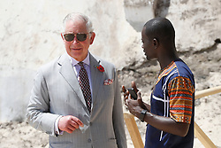 The Prince of Wales with Samuel Acquaah, Head of Education, Ghana Museums and Monuments Board, during a visit to Osu Castle, also known as Fort Christiansborg in Accra, Ghana, on day four of his trip to west Africa with the Duchess of Cornwall.