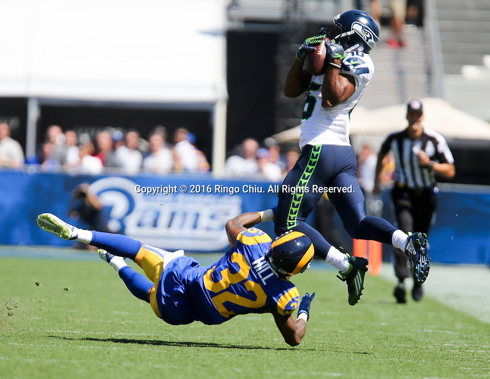 Seattle Seahawks wide receiver Tyler Lockett (16) is tackled by Los Angeles Rams cornerback Troy Hill (32) during a NFL football game, Sunday, Sept. 18, 2016, in Los Angeles. The Rams won 9-3.(Photo by Ringo Chiu/PHOTOFORMULA.com)<br /> <br /> Usage Notes: This content is intended for editorial use only. For other uses, additional clearances may be required.