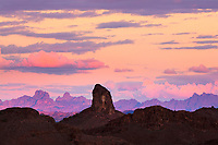 The pastel colors of dusk made my photo of a Southwest sunset of sandstone buttes almost look like a painting. This photograph has layers of the Arizona landscape in shades of purple and pink.