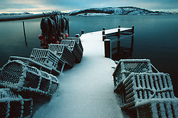 SWEDEN FJALLBACKA JAN04 - A snow-covered pier with Lobster traps overlooks Fjällbacka bay.. . jre/Photo by Jiri Rezac. . © Jiri Rezac 2004. . Contact: +44 (0) 7050 110 417. Mobile:  +44 (0) 7801 337 683. Office:  +44 (0) 20 8968 9635. . Email:   jiri@jirirezac.com. Web:    www.jirirezac.com.