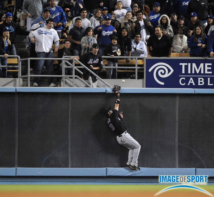 May 6, 2008; Los Angeles, CA, USA; New York Mets right fielder Ryan Church (19) is unable to make a leaping catch at the outfield wall on an inside-the-park home run by Los Angeles Dodgers third baseman Blake DeWitt (not pictured) in the fifth inning at Dodger Stadium.