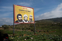 on the left of the poster is Hassan Nasrallah Hezbollahs  current political leader, on the far right is Imad Fayez Mugniyah who was killed in a bomb attack in 2008..