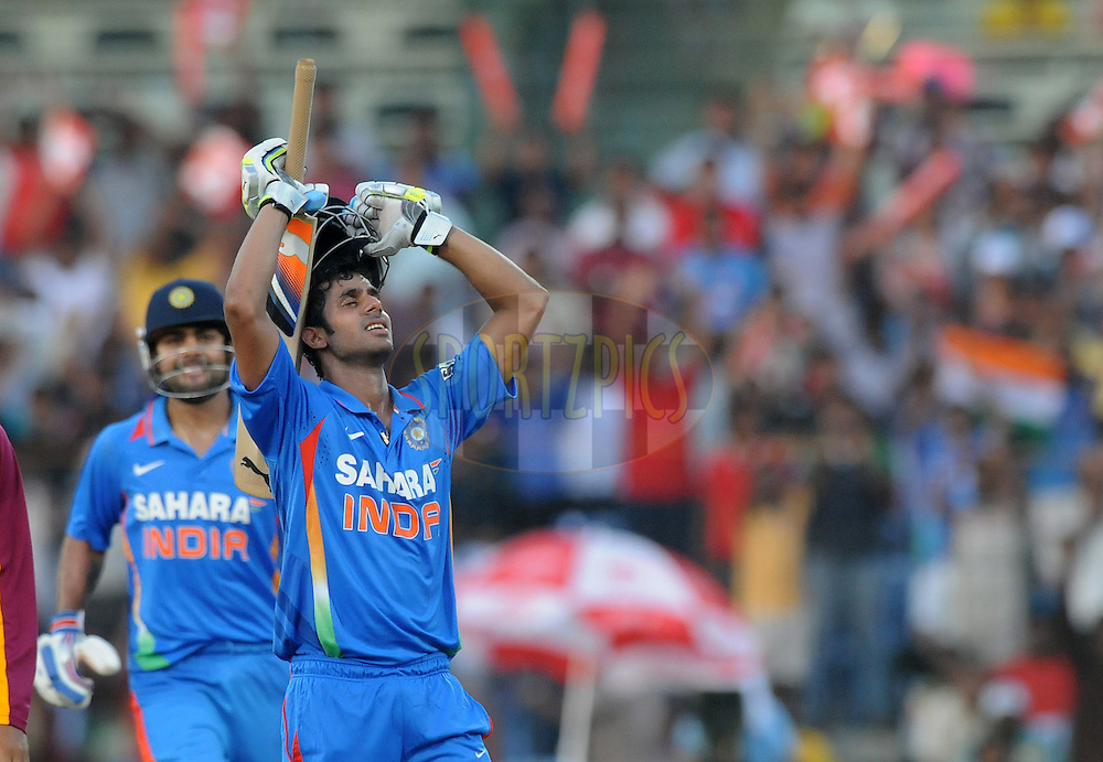 Manoj Tiwary of India celebrate after scoring a century during the 5th ODI ( One Day International ) match between India and The West Indies held at The MA Chidambaram Cricket Stadium in Chennai, India on the 11th December 2011..Photo by Pal Pillai/BCCI/SPORTZPICS