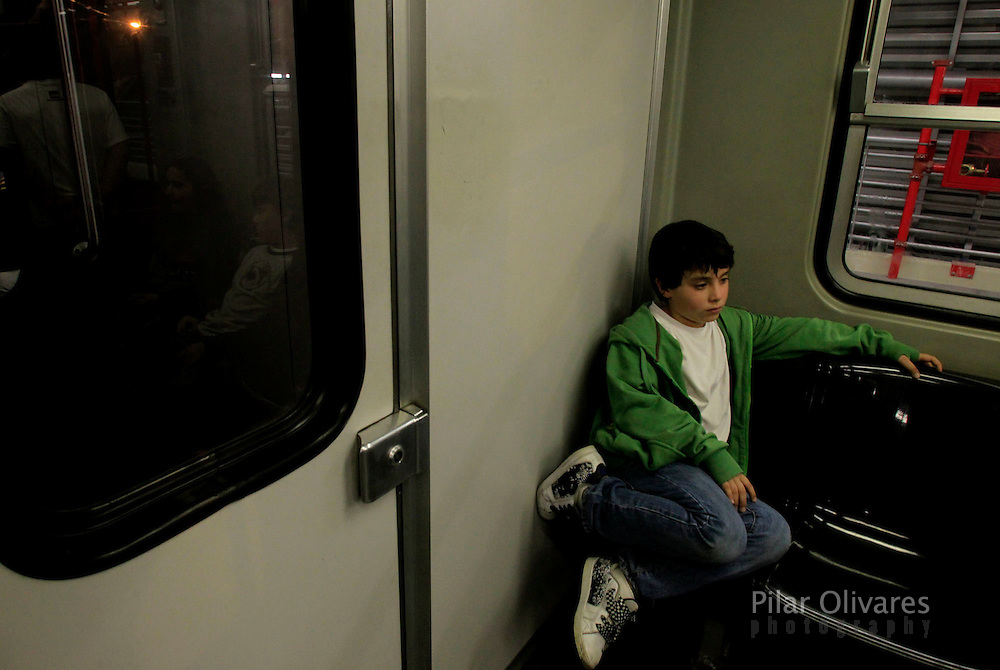 A boy travels inside the electric train during train testing in Lima. (photo: PIlar Olivares)