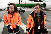 Inspectors Emmanuel and  Nesrine on the airport Roissy Charles de Gaule near Paris. With one order, they can immobilise a Boeing or delay the taking off for 300 passengers on an intercontinental flight. When Operating Technical Inspectors (CTE) get aboard , it is always in pairs and always unexpected. That day, Emmanuel Lain&eacute; (R) and Nesrine Chkioua (L), one of the only three women in France to do this job, control an international flight to Taipei and a cargo plane bound for Lebanon.<br /> <br /> D&rsquo;un ordre, ils peuvent immobiliser un Boeing ou retarder le d&eacute;collage des 300 passagers d&rsquo;un long courrier. Quand les contr&ocirc;leurs techniques d&rsquo;exploitation (CTE) d&eacute;barquent, c&rsquo;est toujours en bin&ocirc;me et toujours &agrave; l&rsquo;improviste. Ce jour-l&agrave;, Emmanuel Lain&eacute; (D) et Nesrine Chkioua (G), l&rsquo;une des 3 femmes CTE en France, passent au crible un vol international pour Taipei et un avion de fret en partance pour le Liban.