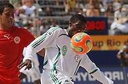 Football-FIFA Beach Soccer World Cup 2006 - Group D-BHR_NGA - Agu-NGA- controls the ball in front of Adnan. - Rio de Janeiro - Brazil 06/11/2006<br />Mandatory credit: FIFA/ Marco Antonio Rezende.
