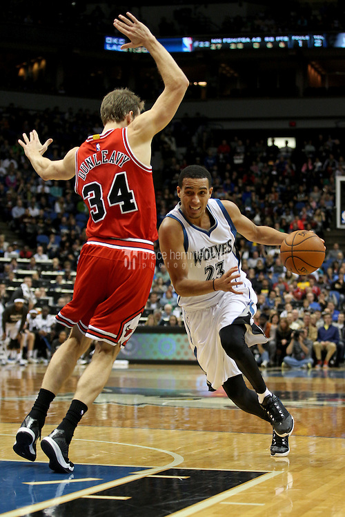 Nov 1, 2014; Minneapolis, MN, USA; Minnesota Timberwolves guard Kevin Martin (23) drives past Chicago Bulls forward Mike Dunleavy (34) during the fourth quarter at Target Center. The Bulls defeated the Timberwolves 106-105. Mandatory Credit: Brace Hemmelgarn-USA TODAY Sports