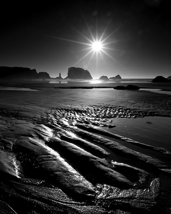 Black and white photograph of patterns in the sand at low tide on the beach at Bandon, Oregon