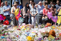 © Licensed to London News Pictures. 26/05/17  MANCHESTER   , UK. <br />  <br /> A sea of flowers and balloons in St Ann's Square , Manchester , today (Friday 26th May 2017) as people gather to remember the victims of the terrorist bomb attack on Monday at the Manchester Arena.<br />   <br /> Photo credit: CHRIS BULL/LNP