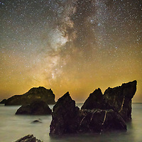 The Milky Way rises above the ocean near Big Sur. © John McBrayer