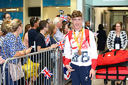 © Licensed to London News Pictures. 20/09/2016. London, UK. Team GB Paralympian Louis Rolfe arrives at terminal 5 of London Heathrow Airport after flying on British Airways flight BA2016. Team GB finished second in the Paralympics medals table with 147 medals beating their total of 120 at London 2012. Photo credit : Tom Nicholson/LNP