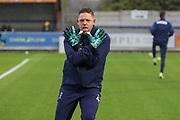 AFC Wimbledon goalkeeping coach Ashley Bayes warming up during the The FA Cup match between AFC Wimbledon and Doncaster Rovers at the Cherry Red Records Stadium, Kingston, England on 9 November 2019.