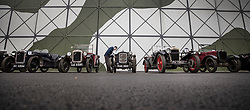© Licensed to London News Pictures. 28/01/2018. Weybridge, UK. Visitors to Brooklands Museum admire a line up of historic vehicles as members of The Vintage Sports-Car Club take part in New Year driving tests round the historic motor racing circuit. Photo credit: Peter Macdiarmid/LNP