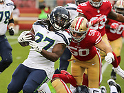 Nov 26, 2017; Santa Clara, CA, USA; Seattle Seahawks running back Eddie Lacy (27) is chased by San Francisco 49ers middle linebacker Brock Coyle (50) at Levi's Stadium.  Seattle beat San Francisco 24-13.