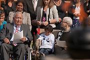 De heer Portier zit met zijn kleinzoon bij het monument. In verzorgingstehuis Rumah Kita in Wageningen wordt de jaarlijkse Indië-herdenking gehouden. Op 15 augustus 1945 capituleerde Japan, maar vlak daarna begon de bersiap periode in voormalig Nederlands-Indië. Met de herdenking wordt stil gestaan bij de roerige tijd, waarbij veel Indo's het land moesten verlaten.<br /> <br /> Mister Portier is attending the commemoration with his grandchild. <br /> Residents of the nursing home for Dutch-Indonesian people Rumah Kita in Wageningen are attending a commemoration for the capitulation of Japan at the Indonesian war. After the war ended a new era started, where most of the Euro-Indonesian people had to leave the country.