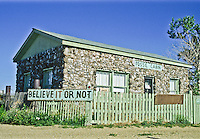 """Oldest house in the world.""  This house was built from 26,000 dinosaur fossils found at the ""Dinosaur Graveyard"" at Como Bluff in Wyoming."