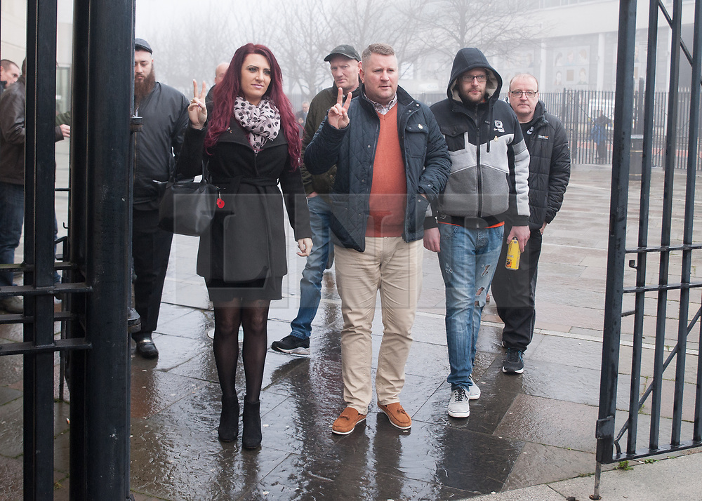 "© Licensed to London News Pictures. 10/1/2018. Belfast, UK. Britain First's leader Paul Golding (3L) with deputy leader Jayda Fransen (2L) arrives at court to make his first appearance after being charged with using ""threatening, abusive, insulting words or behaviour"" following a speech he gave at a rally organised by Independent Belfast City Councillor Jolene Bunting last year. Ms Fransen has been criticised after appearing in a video showing her sitting in robes in the Lord Mayor's chair inside Belfast City Hall. The council are investigating.   Photo credit: John Rymer/LNP"