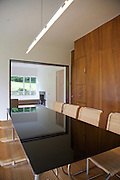 """The dining room showing the """"green table"""" (referring to the reflections) looking through to the living room at Warren House, Wayne McGregor's Dartington Estate home in Devon<br /> Vanessa Berberian for The Wall Street Journal"""