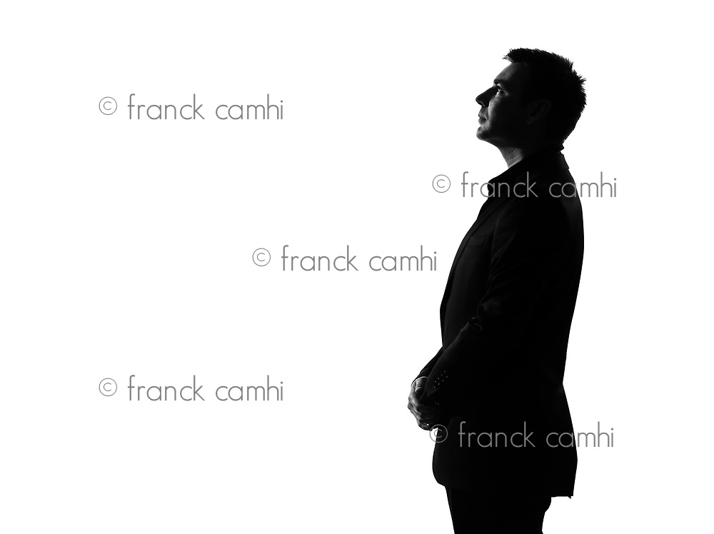 silhouette caucasian business man   profile serious looking up expressing behavior full length on studio isolated white background