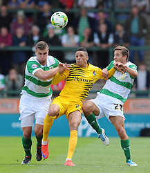 Daniel Leadbitter of Bristol Rovers is tackled by Jakub Sokalik of Yeovil Town and Wes Fogden of Yeovil Town - Photo mandatory by-line: Harry Trump/JMP - Mobile: 07966 386802 - 15/08/15 - SPORT - FOOTBALL - Sky Bet League Two - Yeovil Town v Bristol Rovers - Huish Park, Yeovil, England.