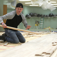 Logan Petty, an installer with The Court Company, of Memphis, installs new flooring in the aerobics room at the Wellness Center. The NMMC Wellness Center will start the new year with a shiny, fresh floor for its aerobics room. The floor had been refinished several times and couldn't be sanded further. The new floor is expected to be ready for happy feet by mid-January. The center, which will celebrate its 30th anniversary in September 2019, has also replaced saunas, installed a new heater for its whirlpool and incorporated new fitness equipment over the past year. It remains the only Medical Fitness Association certified facility in Mississippi.