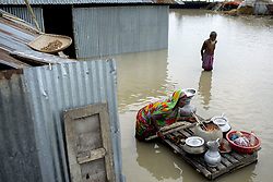 August 16, 2017 - Bogra, Bangladesh  - A woman cooks food in the floodwaters in the Manikdi area at Bogra. (Credit Image: © K M Asad via ZUMA Wire)