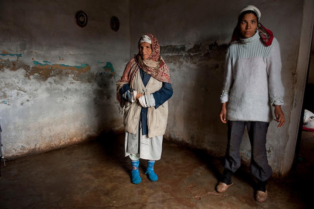 """Sejenane is a forgotten city: 63% unemployment, poverty is widespread..Here 2 residents of the """"French village"""" a slum that occupies houses dating from 1911 in the former iron mine.<br /> Sejenane is in the grip of violent Salafis who rule here  since April 2011.<br /> <br /> <br /> Sejenane est sous l'emprise des  Salafistes violents qui y font la loi et y ont installé un régime de terreur depuis avril 2011. .Sejenane est une ville oubliée: 63 % de chomage, la pauvreté est omniprésente. Ici deux habitantes du """"village français"""" une bidonville qui occupe des locaux datat de 1911 de l'ancien mine de fer."""