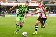 Forest Green Rovers Aaron Collins(10) fends offExeter City's Archie Collins(27) during the EFL Sky Bet League 2 match between Exeter City and Forest Green Rovers at St James' Park, Exeter, England on 12 October 2019.