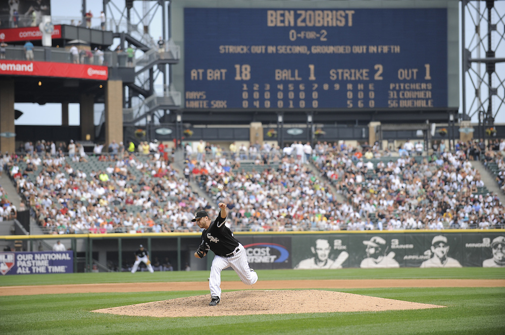 CHICAGO - JULY 23:  Mark Buehrle #56 of the Chicago White Sox pitches in the eighth inning against the Tampa Bay Rays on June 23, 2009 at U.S. Cellular Field in Chicago, Illinois.  Buehrle pitched the 18th perfect game in major league baseball history as the White Sox defeated the Rays 5-0.  (Photo by Ron Vesely)