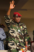 "Guinea president Captain Moussa Dadis Camara waves during an official visit at the Kofi Annan private university in Conakry, Guinea on Thursday March 5, 2009. Camara, who took power after a coup in December 2008, was visiting the university to ""meet the youth"", as part of his efforts to solidify his support from Guinea's population.(Olivier Asselin for the New York Times)"
