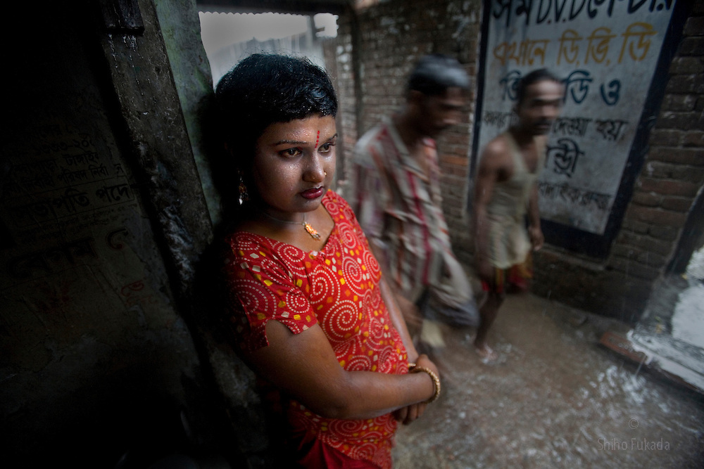 Sex worker Shuri, 15, waits for a customer at brothel, June 7, 2007 in Tangail, Bangladesh. Shuri was born into brothel and adopted by another sex worker. <br />
