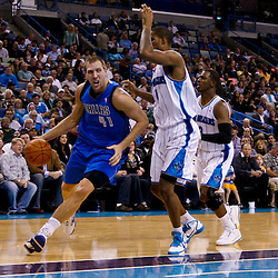 November 17, 2010; New Orleans, LA, USA; Dallas Mavericks power forward Dirk Nowitzki (41) of Germany drives past New Orleans Hornets small forward Trevor Ariza (1) during the first half at the New Orleans Arena. Mandatory Credit: Derick E. Hingle