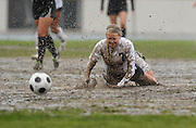 Camarillo's Alexis Bramwell slides into the mud after being tripped up during their game with Pacifica on February 6, 2014.