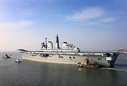 © under license to London News Pictures.  24/03/2011 HMS Invincible is towed from Portsmouth Dockyard on her final journey. She is to be delivered to Turkey where she will broken up for scrap. Picture credit should read: Bryan Moffat/London News Pictures