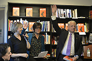Rockville Centre, New York, USA. April 201, 2018. L-R, When CAROL HOENIG asks a question, RITA KESTENBAUM and Rep. STEVE ISRAEL raise their hands, meaning Yes, at special event for Nassau County debut of the former Congressman's (NY - Dem) newest novel BIG GUNS - a satire of the strong gun lobby, weak Congress, and a Long Island town. Moderator RITA KESTENBAUM is a gun-control activist, non-profit founder, and former councilwoman whose daughter was shot to death at college. Hoenig is co-owner of Turn of the Corkscrew Books & Wine store, where event was held.