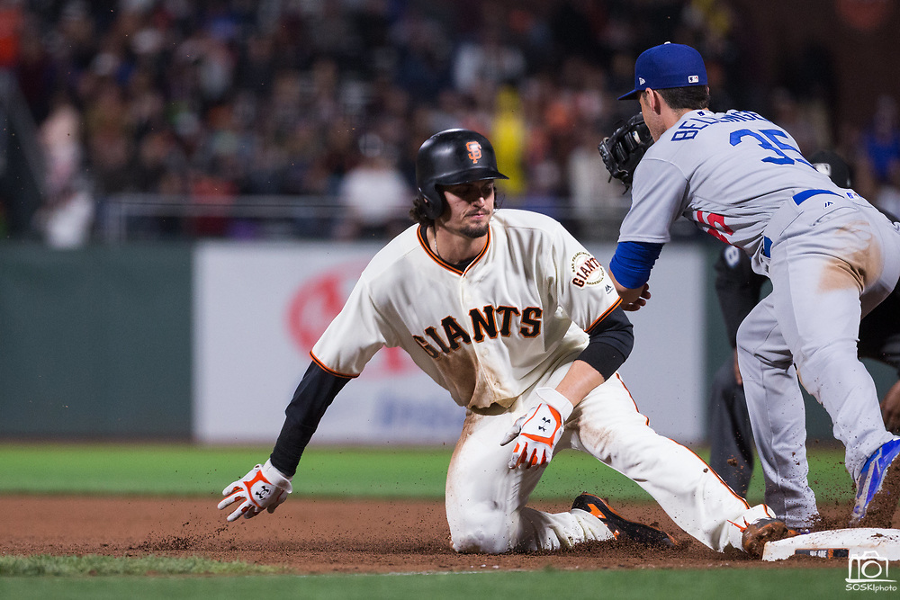 San Francisco Giants left fielder Jarrett Parker (6) is tagged out at first base by the Los Angeles Dodgers at AT&T Park in San Francisco, California, on September 13, 2017. (Stan Olszewski/Special to S.F. Examiner)